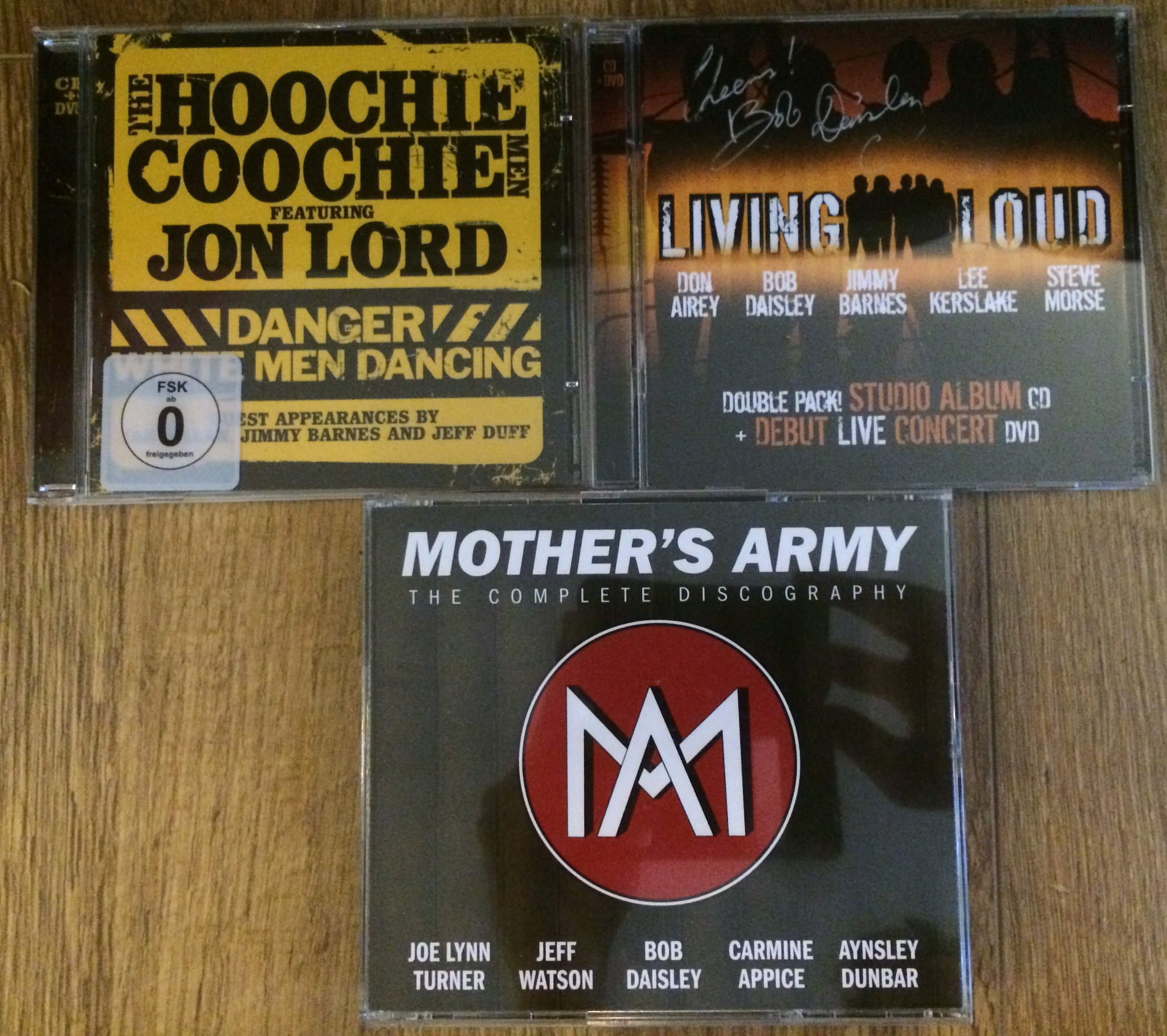 Signed CDs from Mother's Army, Living Loud & the Hoochie Coochie Men
