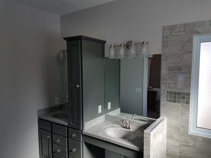 vanity and walk-in shower after a remodel by CorHome