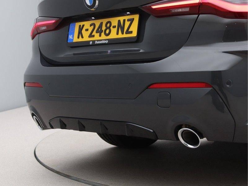 BMW 4 Serie 420i Coupé High Exe M-Sport Aut. afbeelding 20