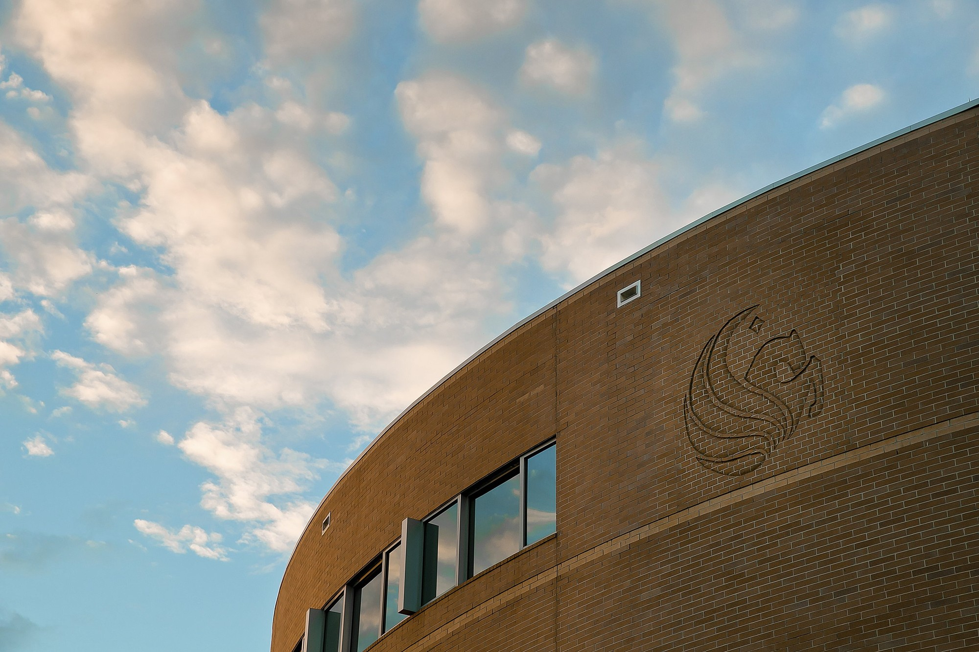 Up close image of the UCF logo on a campus building