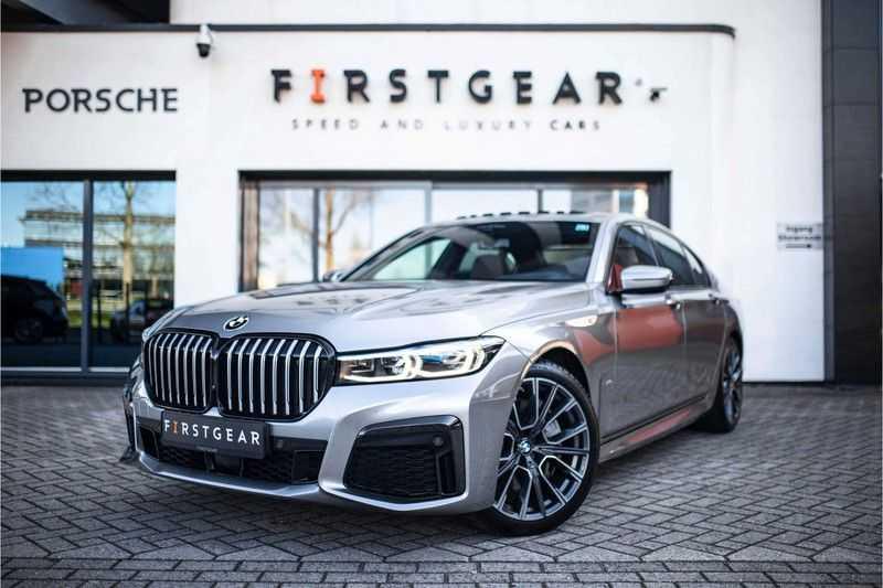 BMW 7 Serie 740d xDrive *Schuifdak / H&K / Memory / LED / ACC / Stoelventilatie* afbeelding 1