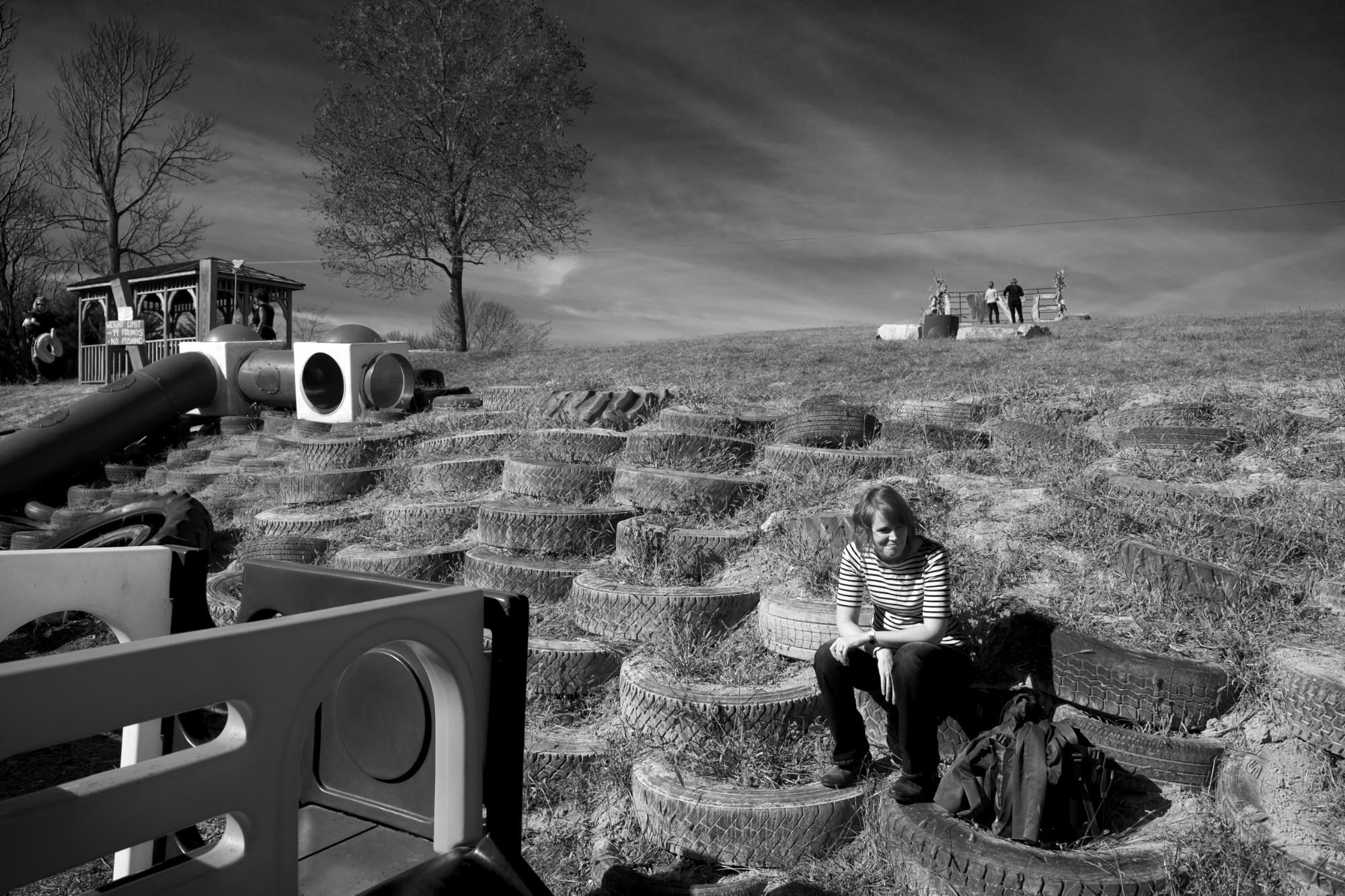 <p>My wife, Jackie, chilling on a pile of old tires.</p>\n