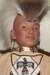 close up of Native American warrior doll