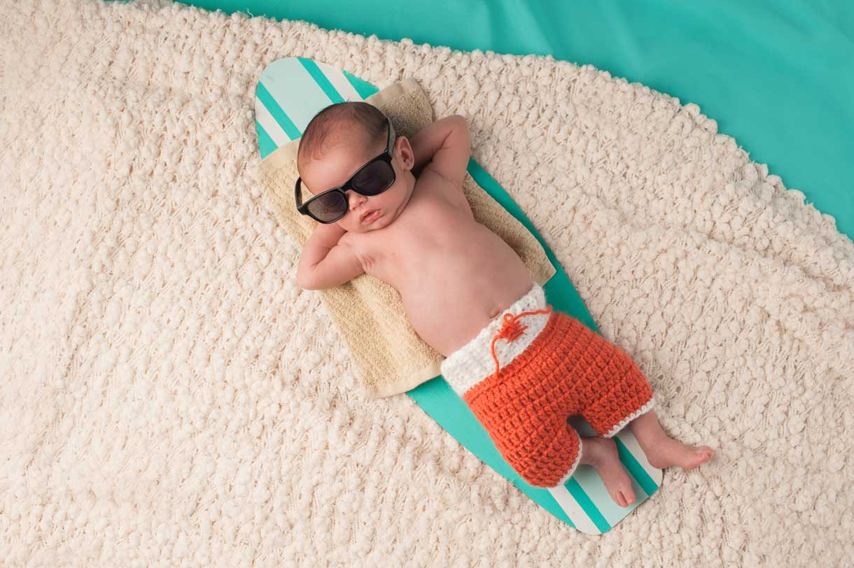Baby relaxing on a surf board