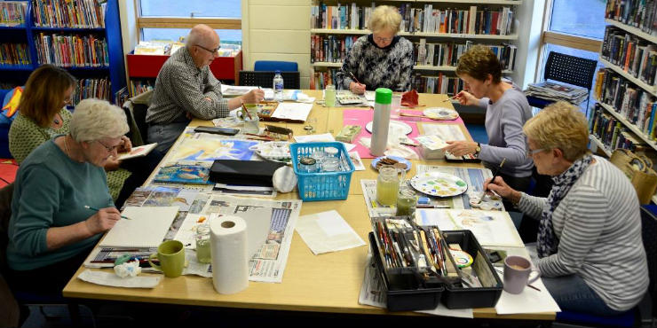 Older people participating in an art group