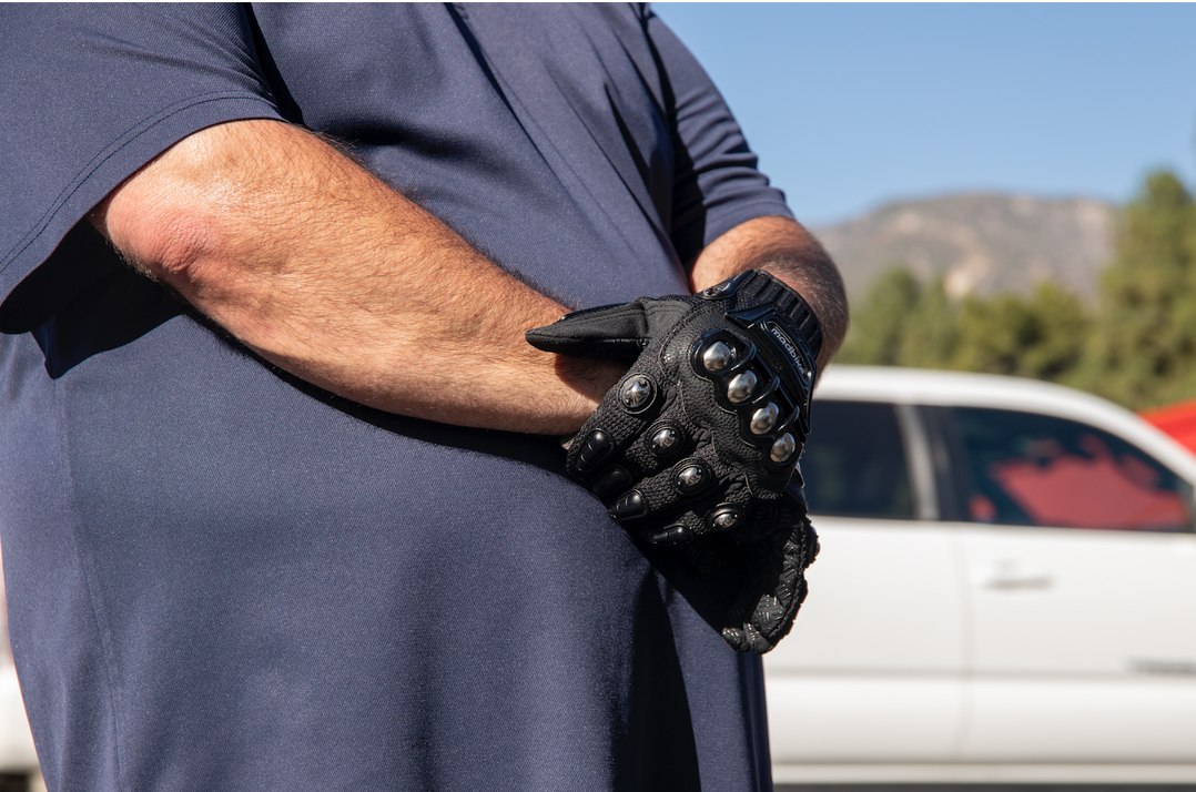 Far-right supporter wearing metal studded gloves.