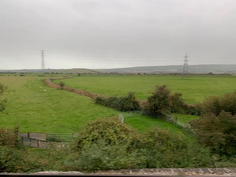 A view of fields seen from the train between Lewes and Newhaven.