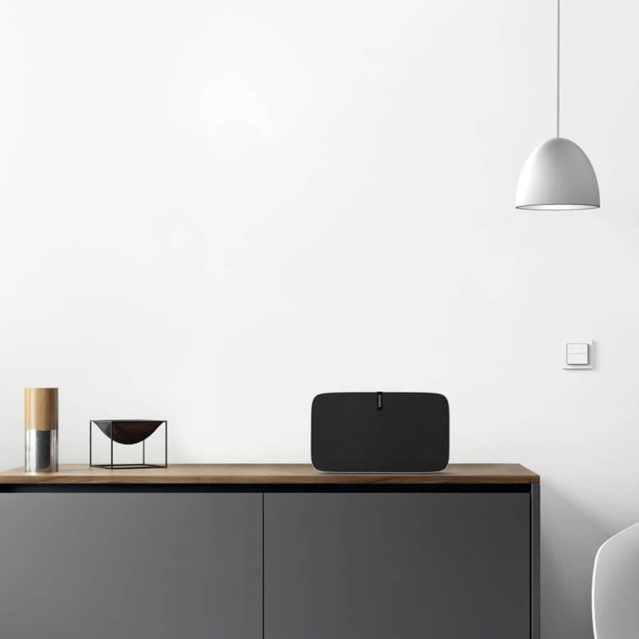 white nuimo click with sonos and philips hue in designer home