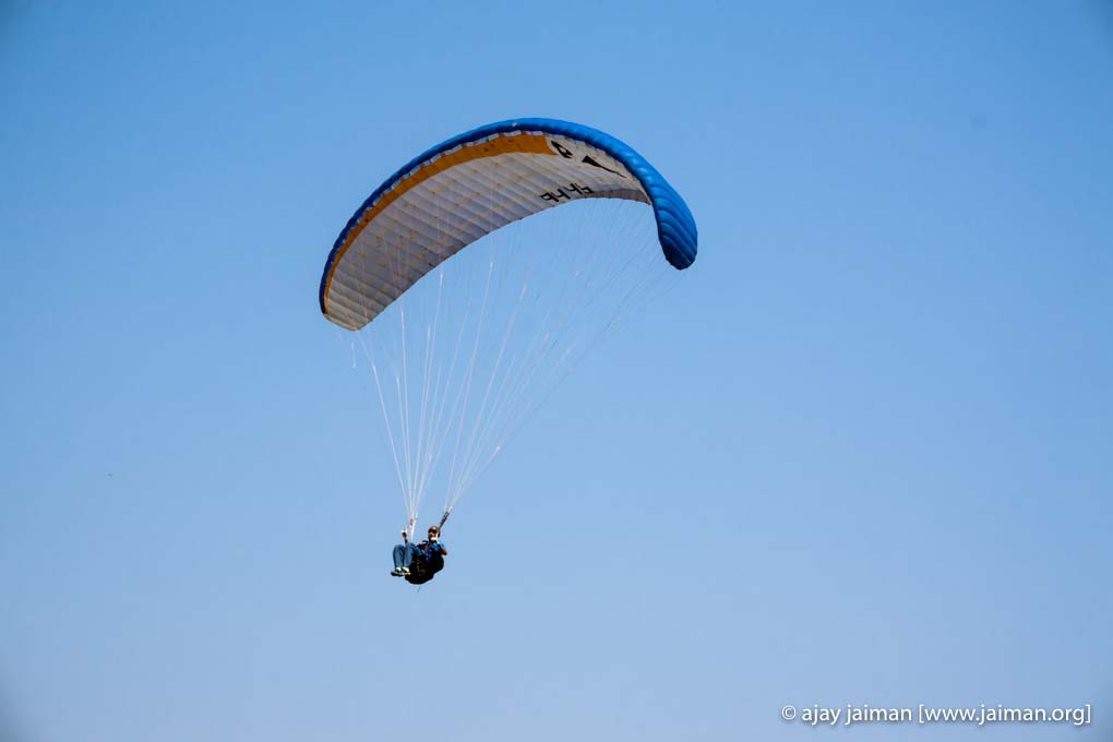 That is me on one of my first solo paraglider flights in Kamshet