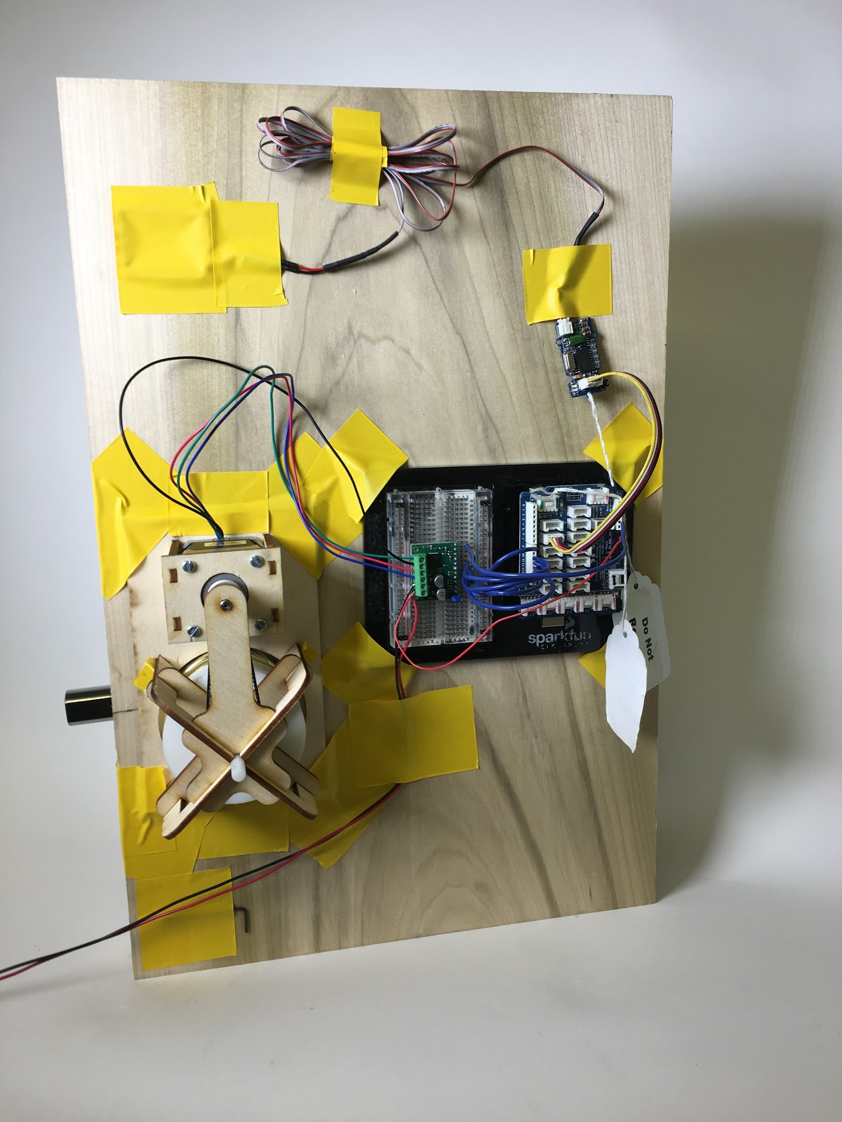 Device mounted on testing board with breadboarded electronics