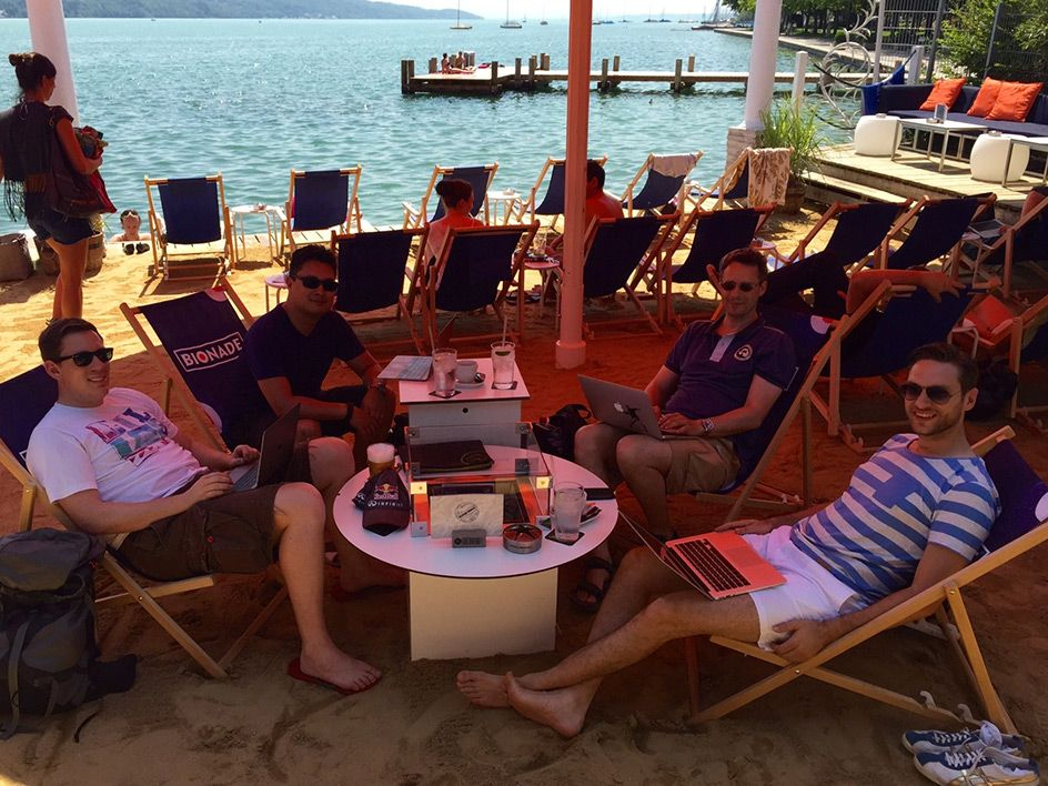 Founders working at the Lake in folding chairs