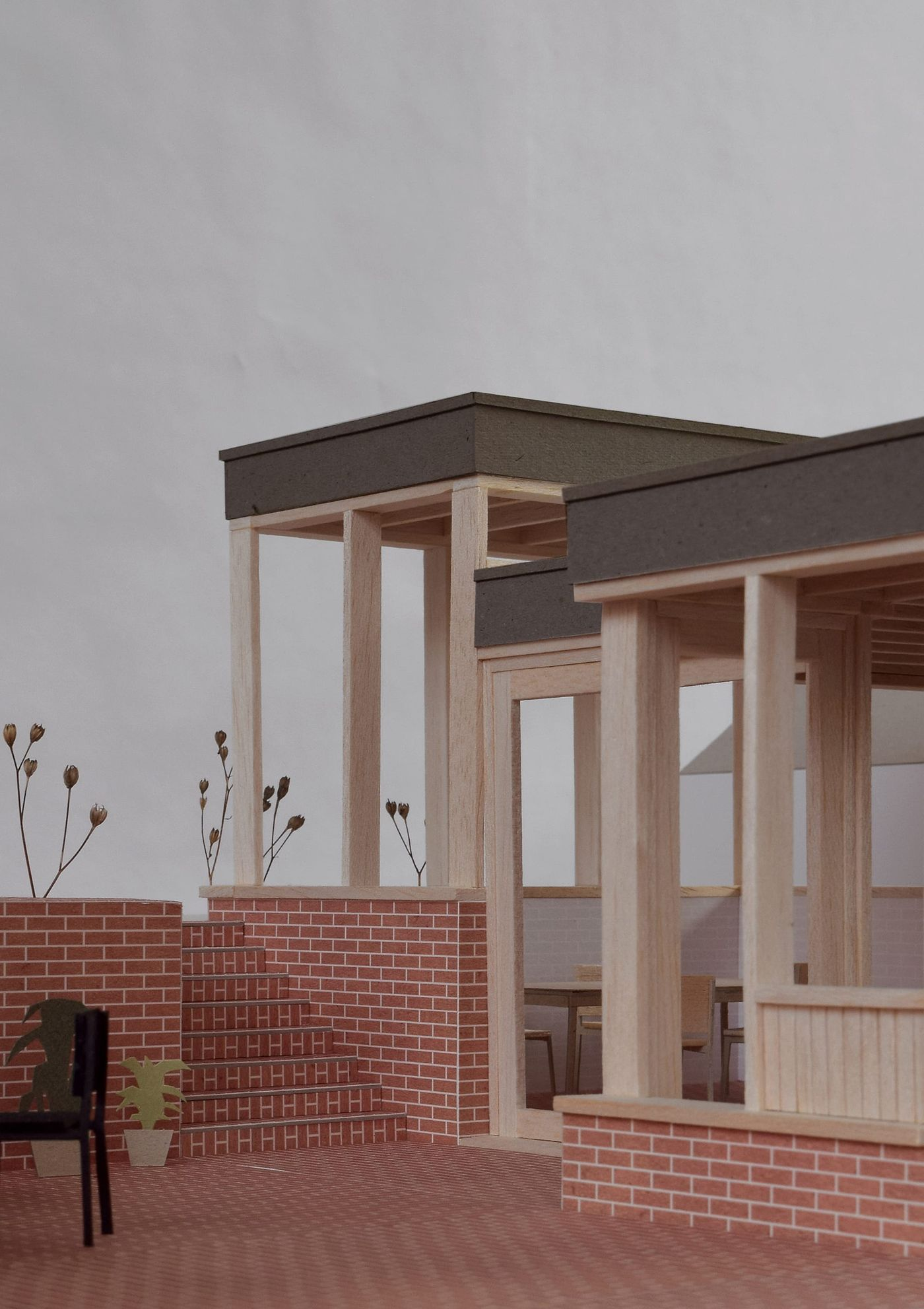 External model photograph for From Work's stepped brick and timber rear extension.