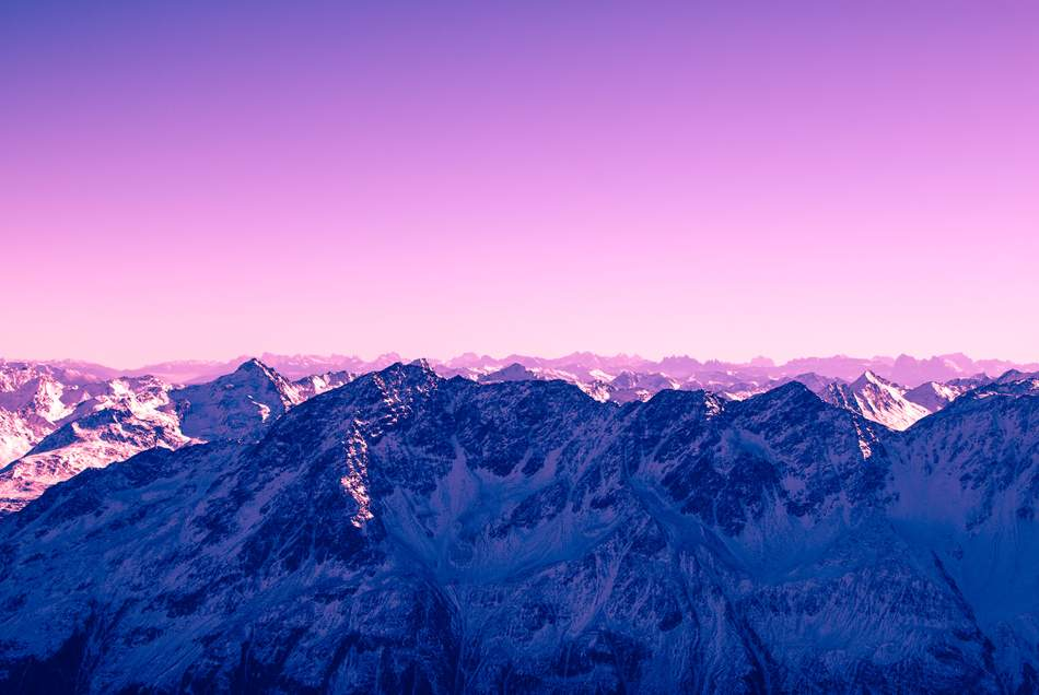 A purple image of mountains, the same colour as the Gatsby JS logo, Next Gen Websites, future of the internet