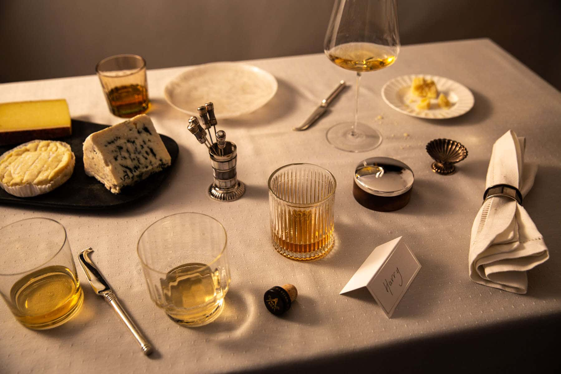 selection of cheese and whiskeys on a table party vibe