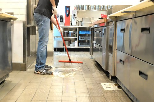 Halo employee mopping commercial kitchen floors