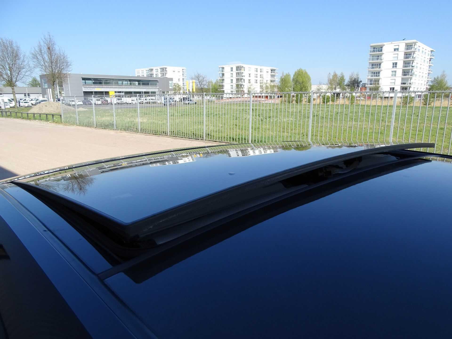 BMW i3 Basis Comfort Advance 22 kWh Marge Warmtepomp Navigatie Clima Cruise Panorama afbeelding 4