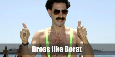 For his more covered outfit, Borat wears a gray business suit, a dark gray dress shirt underneath, a beige necktie, and respectable black Oxfords.