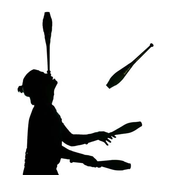 Silhouette of woman juggling