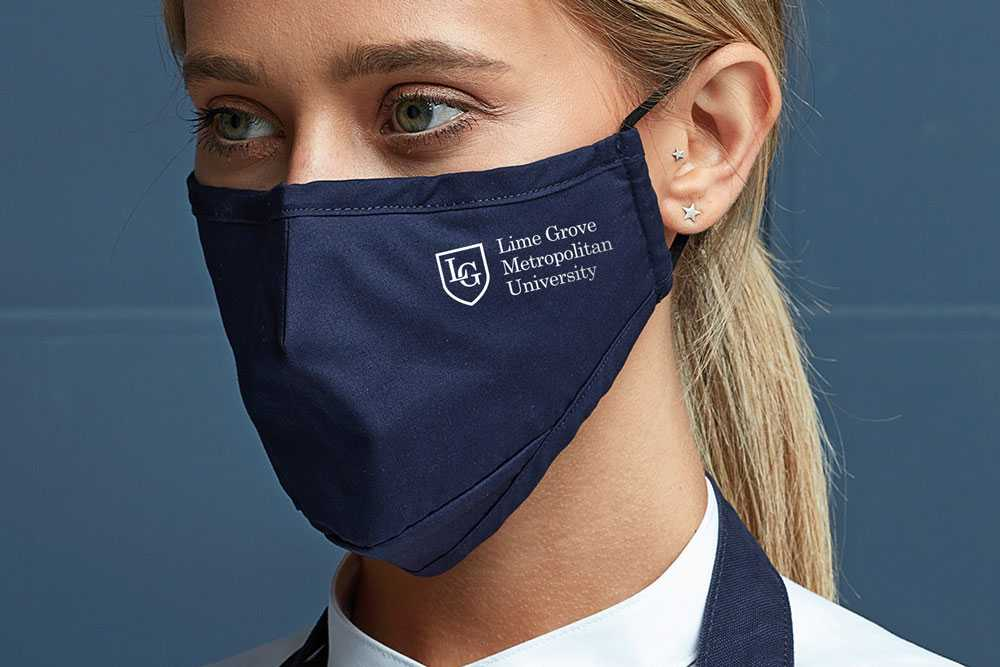 woman in navy blue face mask with university logo printed on the side
