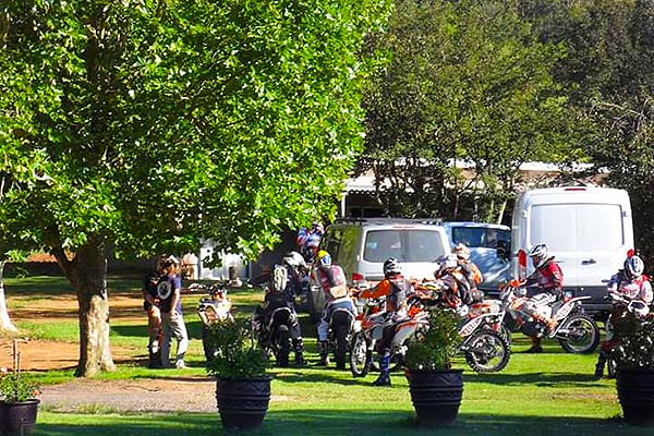 A group of off-road motorcyclists.