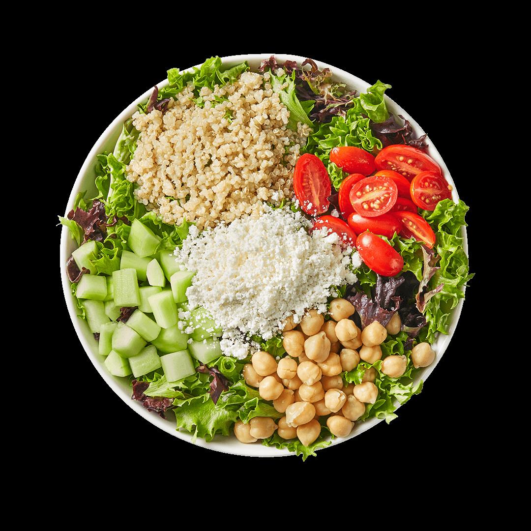 Photo of a fresh Goddess Salad, loaded with veggies.