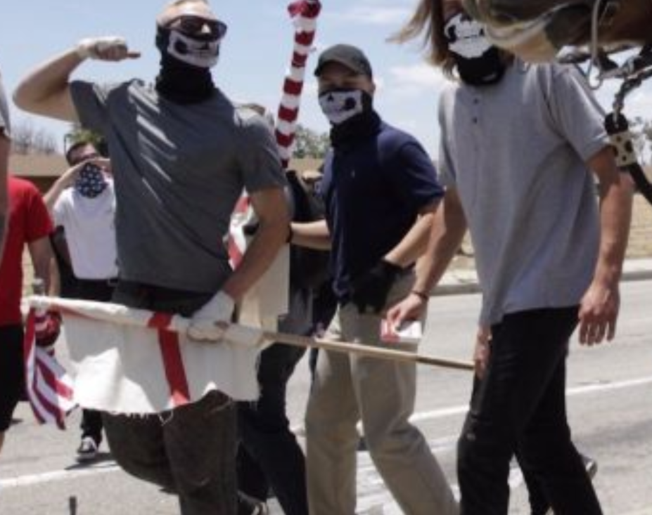 Ryan (center, blue polo) marches alongside Benjamin Daley at the anti-Sharia law San Bernadino protest June 10th, 2017