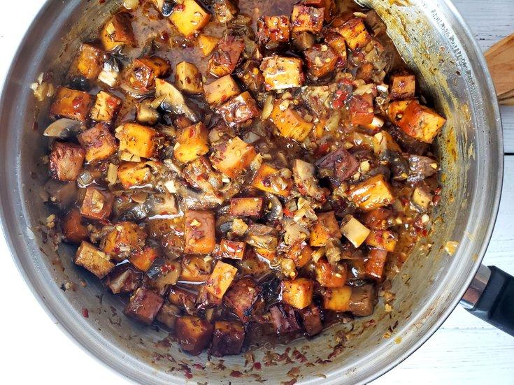 Cooked Jerked Tofu, Portobello Mushrooms, and Onion