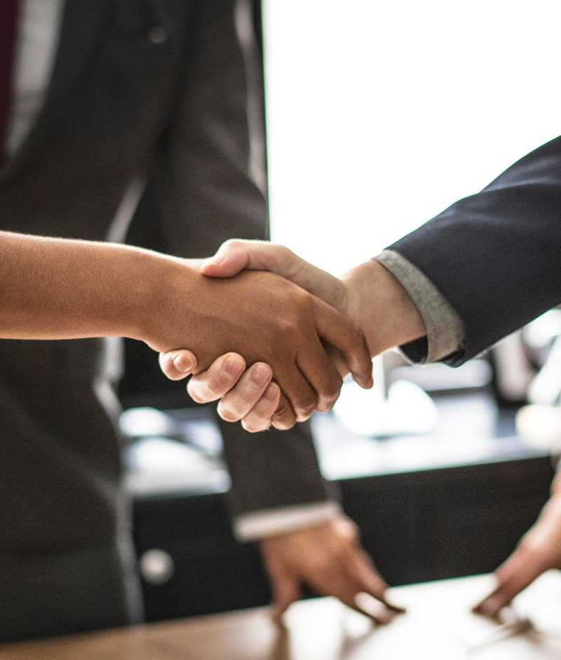 People shaking hands after business deal