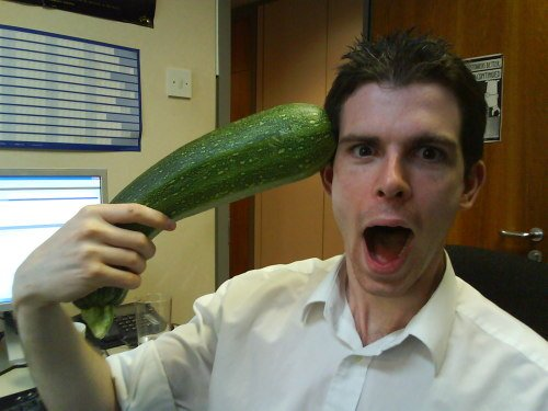 Camera Phone shot of Mike shooting himself with an oversized Courgette
