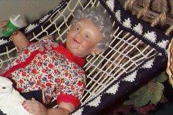 old lady doll in hammock