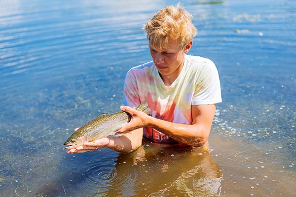 A person holding a fish they caught.