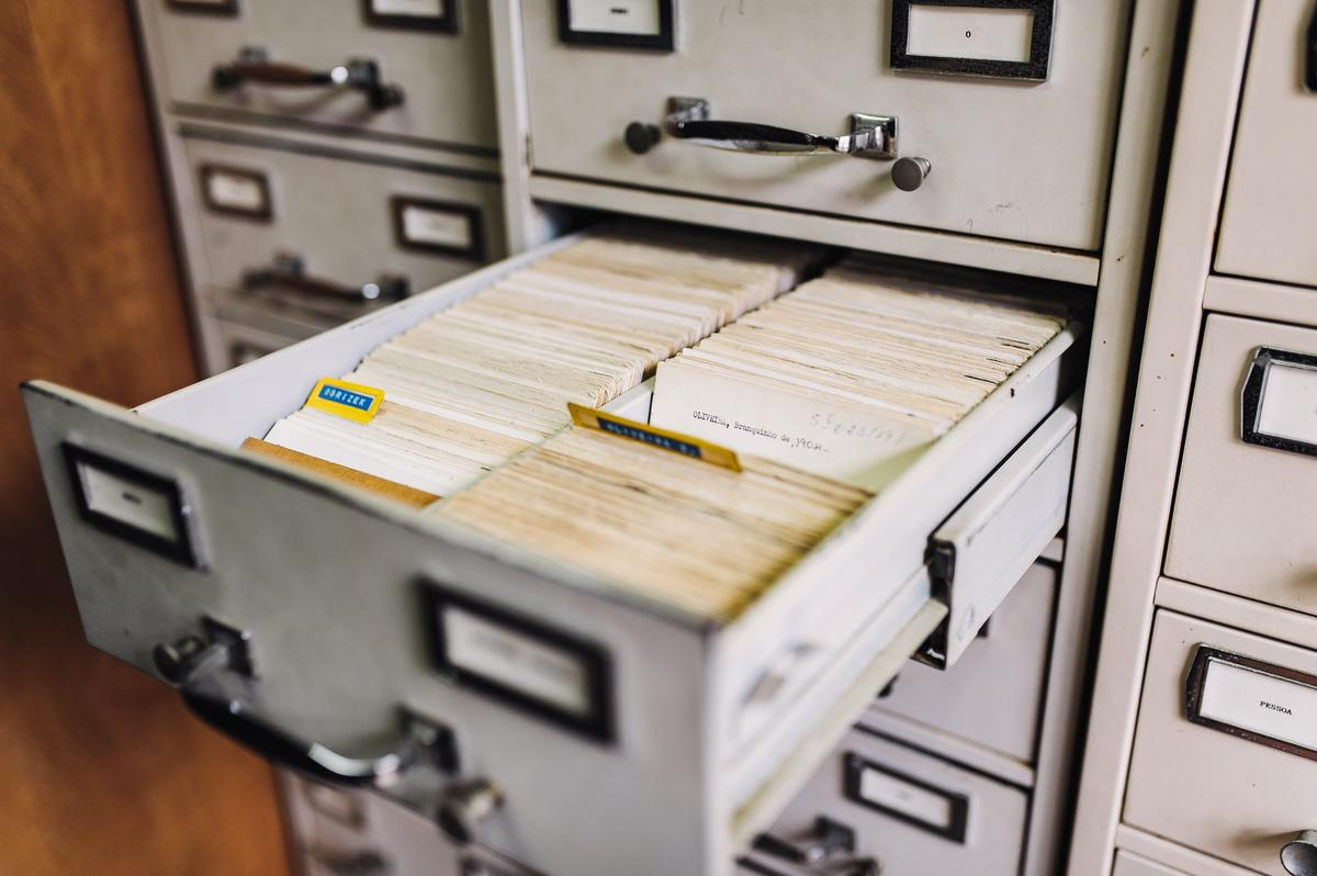 File cabinet with an open drawer containing index cards.