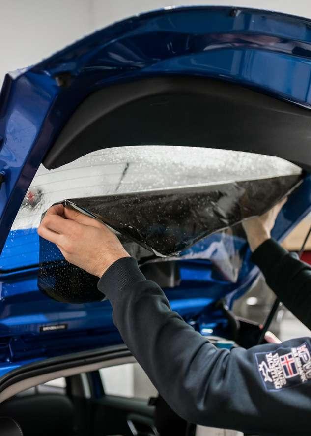 LLumar window tinting film beign applied to rear window of car Blue MG3