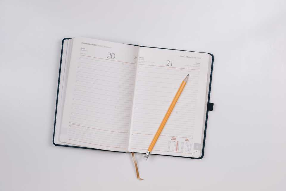 Notebook calendar planner lies on a desk with a pencil for planning 2020, the year ahead at the start of the year planning for trends in the accountancy industry