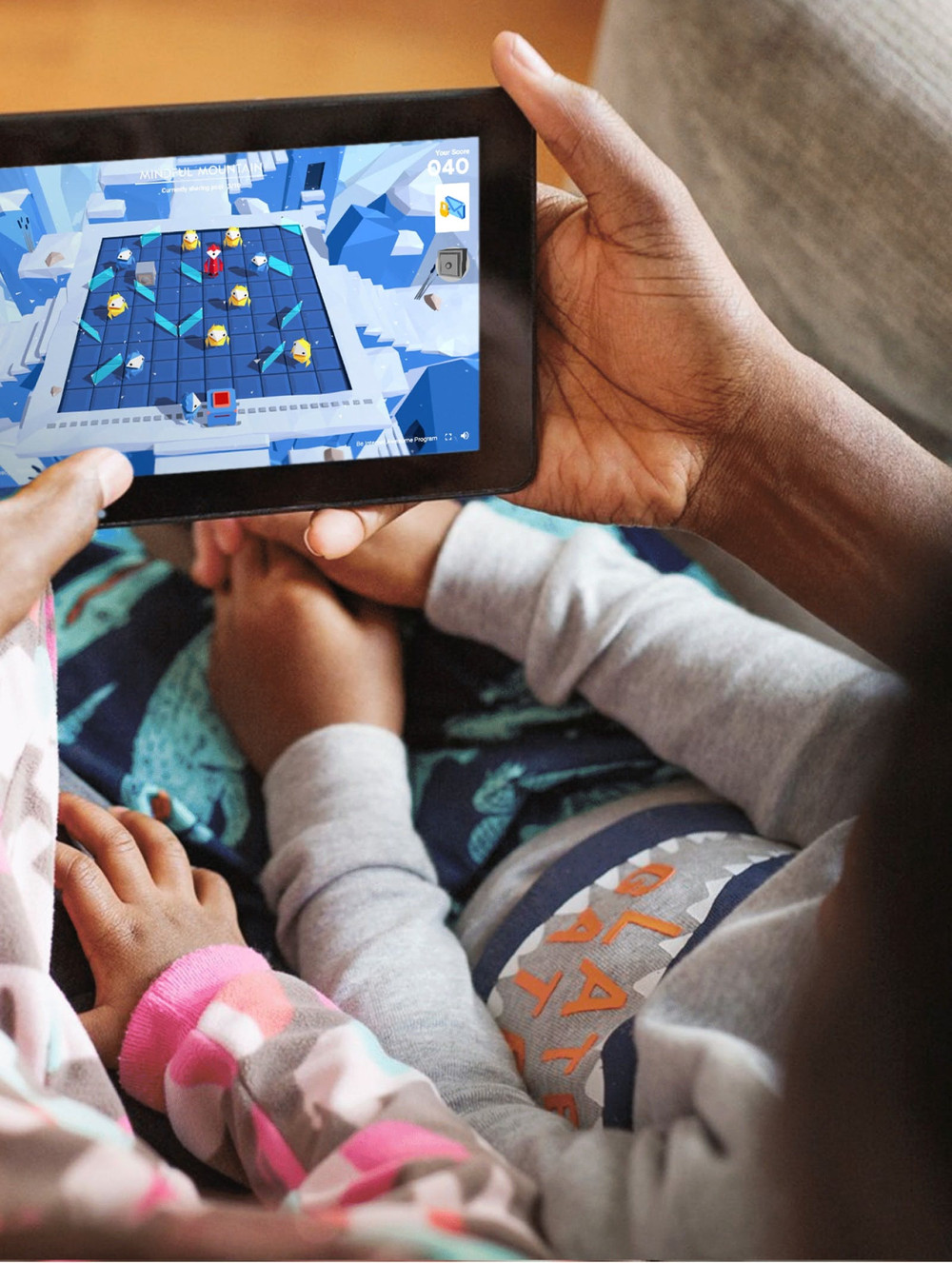Parent playing Google Interland with children