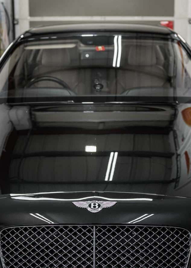 Bentley Flying Spur car bonnet after polishing, paint correction and paint enhancement with no scratches