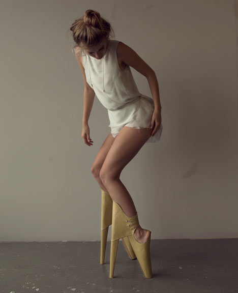 The model, bent severely at the knees, shoes creating an atypical posture in her apparent search for high fashion.