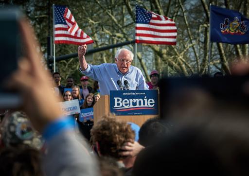 Bernie Sanders giving speech on lecturn outside.