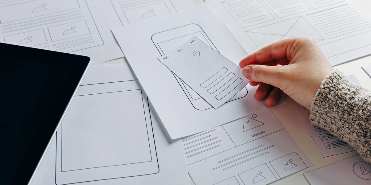 Some low-fidelity wireframes hand-drawn by a UX designer