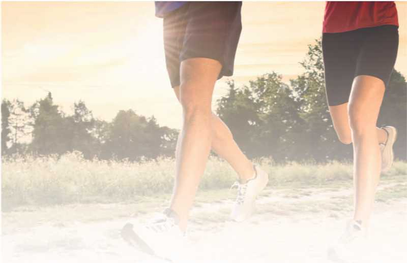 Joggers running in black shorts and a red and blue shirt