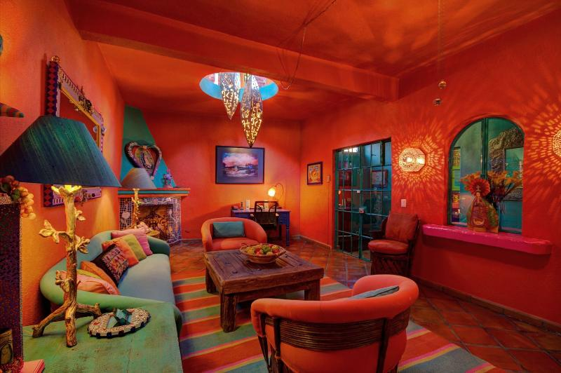 The salon, or living room is just off the vestibule. It is the perfect room for entertaining guests.