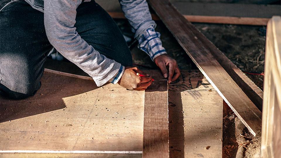 Man measuring boards