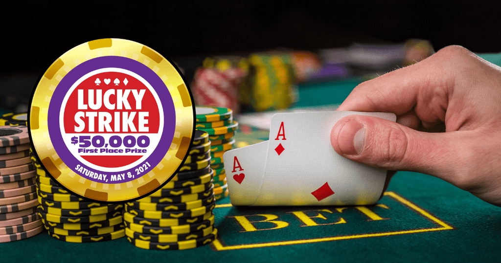 Image of 2 aces on a poker table with a stack of chips next to them with the Lucky Strike Charitable Poker Tournament logo overlaid on top