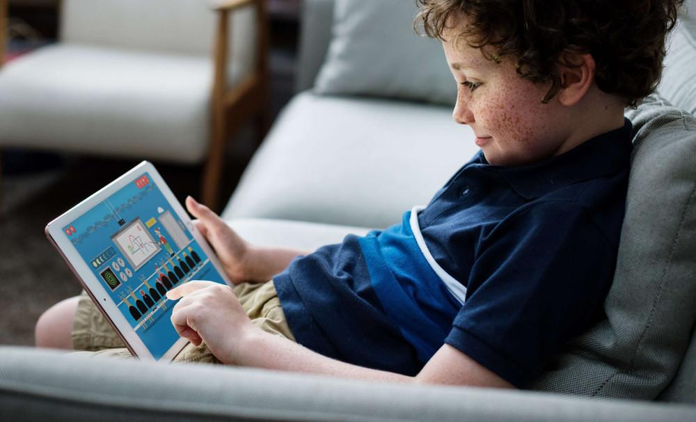Boy playing Google Santa Tracker on a tablet