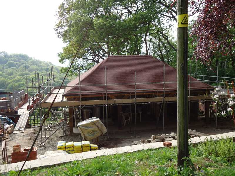 A new timber framed garage having its roof installed