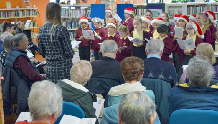 Schoolchildren sing carols to elderly people at Chantry Library