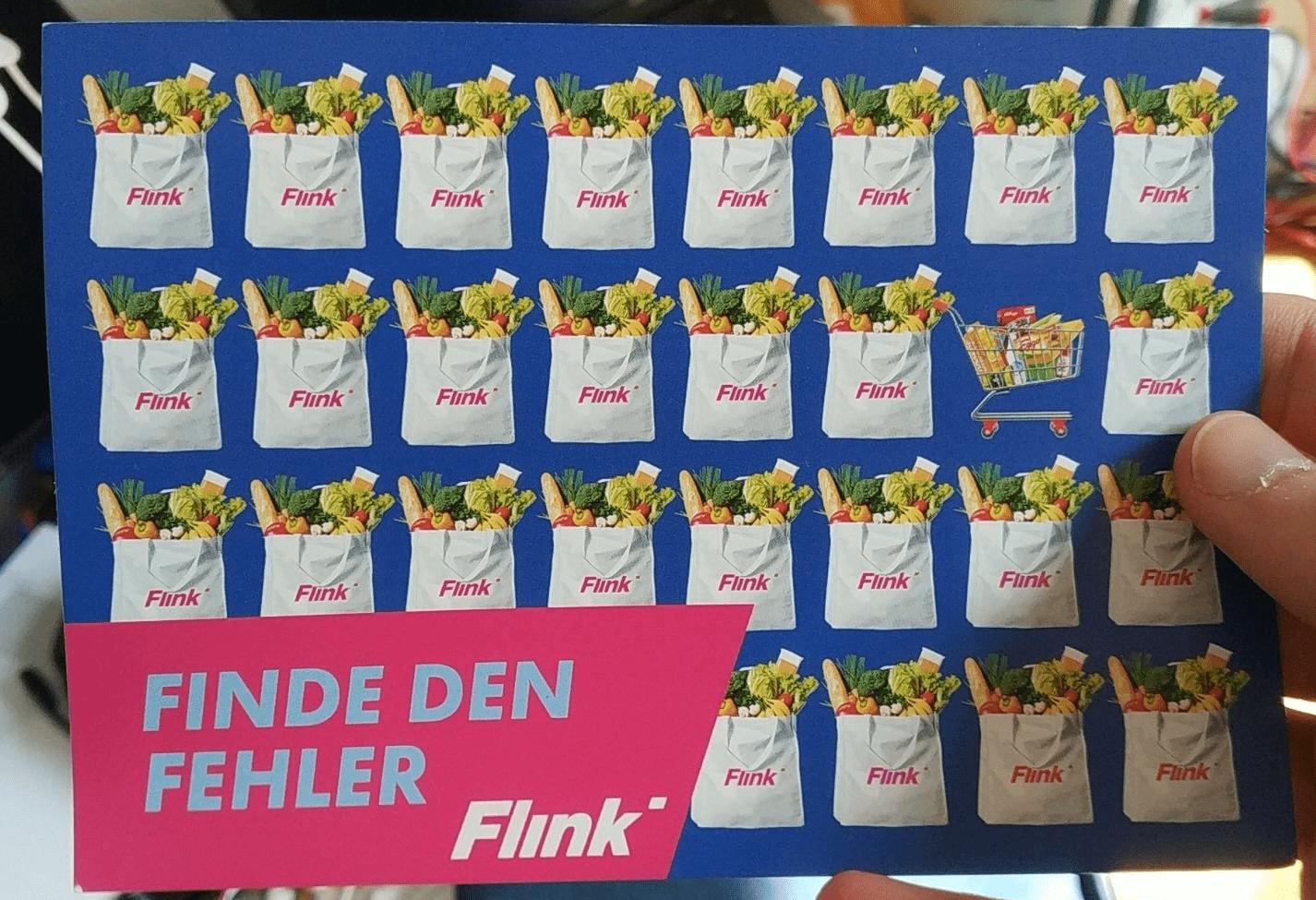 Werbe-Postkarte von Flink mit dem Slogan 'Finde den Fehler'