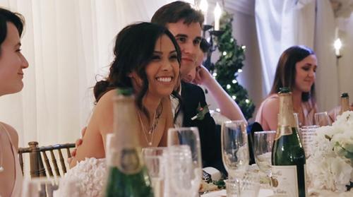 Cynthia smiling at father's wedding toast