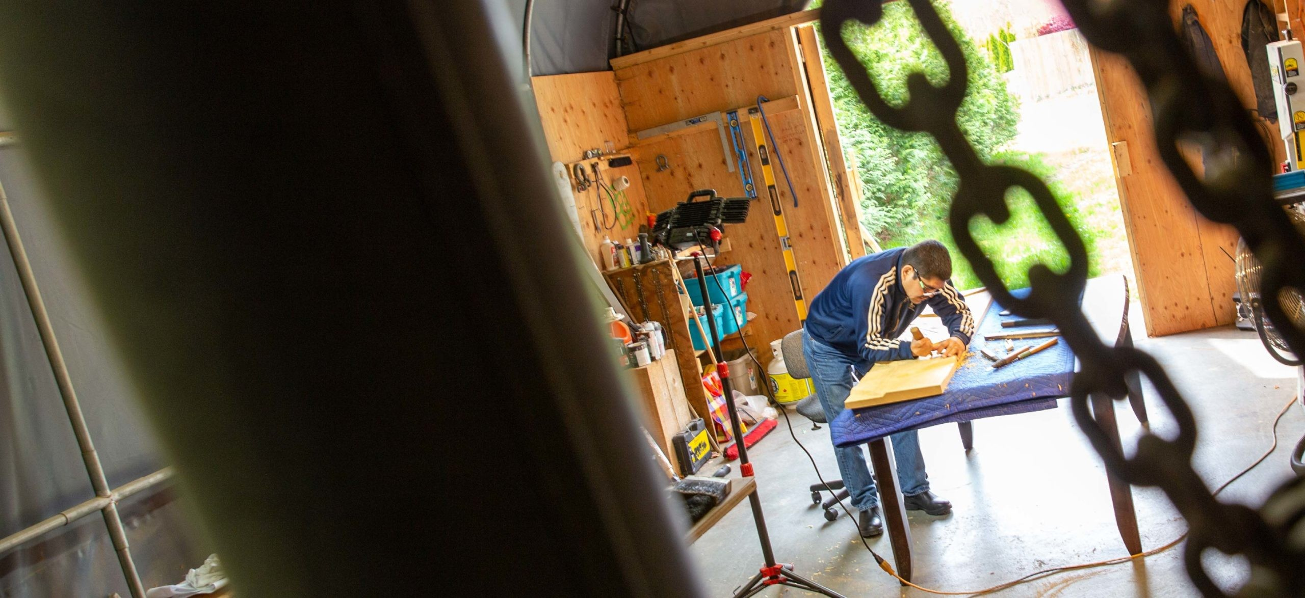 Musqueam artist Brett Sparrow carves artwork in his workshop