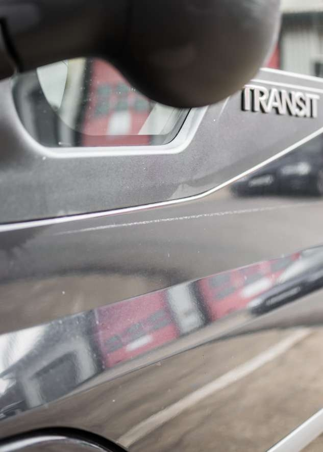 Close up shot of big scratch on paintwork on Ford Transit van